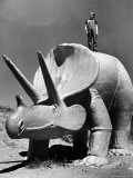 """Young Boy Standing Atop Large Statue of Dinosaur in """"Dinosaur Park"""" Tourist Attraction Photographic Print by Alfred Eisenstaedt"""