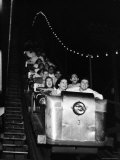 Teenagers in Rollercoaster at Night Reproduction photographique sur papier de qualité par Gordon Parks