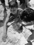 Settlement House Children Burying Boy under Sand at the Beach Premium Photographic Print by Martha Holmes