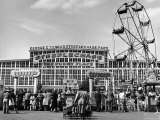 People Entering Coney Island Amusement Park Photographic Print by Ed Clark