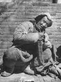Typical Mongol Type Sitting by Street Premium Photographic Print by George Lacks