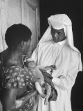 Sister Joseph Theresa Caring For Child Sick from Hunger Premium Photographic Print by Terence Spencer