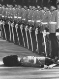 Member of Honor Guard Lying on the Ground After Fainting During Ceremonies For Queen Elizabeth Photographic Print by John Loengard