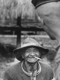Vietnamese Montagnard Man Smoking Cigarette Premium Photographic Print by Larry Burrows