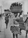 Nigerian Women with Babies Strapped to Their Backs Carrying Large Baskets on Their Heads Photographic Print by Alfred Eisenstaedt