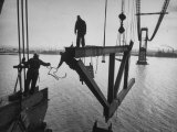 Raising the Truss, Men of the Raising Gang Ride the Swinging Steel 160 Feet Above the Water Premium Photographic Print by Peter Stackpole