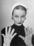 Model Martha Boss, Modeling Mismatched Gloves Premium Photographic Print by Nina Leen