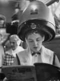 Woman Sitting under Hair Dryer Reading a Magazine Premium Photographic Print by Gordon Parks