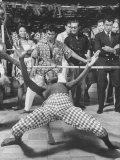 Professional Limbo Dancer Performing with Ease Premium Photographic Print by Ralph Crane