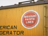 Railroad Box Car Showing the Logo of the Missouri Pacific Railroad Premium Photographic Print by Walker Evans