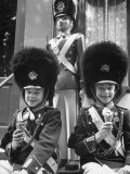 Young Boys Dressed Up as Tivoli Guards Resembling Nut Crackers, Enjoying Their Ice Creams Premium Photographic Print by Carl Mydans