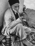 Old Muslim Enjoying Last Smoke Before Entering the Mosque For Friday Afternoon Service Premium Photographic Print by Stan Wayman