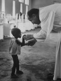 Roman Catholic Priest Chatting with Healing Child Photographic Print by Terence Spencer