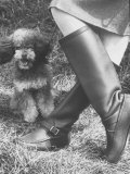 Woman Wearing a Pair of Classic Knee High Hunting Boots Photographic Print by Paul Schutzer
