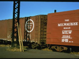 Railroad Box Cars with the Logos of the Atlantic Coast Line and Milwaukee Road Railroads Premium Photographic Print by Walker Evans