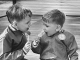 Two Boys with Lollipops Premium Photographic Print by Nina Leen
