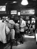 Patrons Inside P.J. Clarke's Saloon Include Men Wearing Bermuda Shorts, a New Fad Premium Photographic Print by Alfred Eisenstaedt
