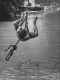 Patrick Powell Swinging on Rope over River Premium Photographic Print by Vernon Merritt III