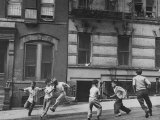 Young Boys with Sticks, Running Around While Playing a Street Game in Spanish Harlem Premium Photographic Print by Ralph Morse