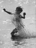 Patrick Powell Playing in Water Premium Photographic Print by Vernon Merritt III