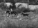 Patrick Powell Horseback Riding Premium Photographic Print by Vernon Merritt III