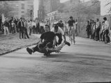 Youths Riding Skateboard Premium Photographic Print by Bill Eppridge