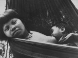 Mother Swinging with Her Baby in a Hammock Premium Photographic Print by Stan Wayman