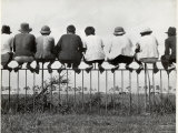 Vietnamese Men Perching Like Birds Atop an Iron Fence to Watch the Sunday Pony Races Premium Photographic Print by Jack Birns