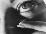 Woman Preparing to Insert Contact Lens Into Her Eye Premium Photographic Print by Henry Groskinsky
