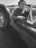 Well Dressed Woman Behind the Wheel of a Foreign Made Roadster Premium Photographic Print by Nina Leen