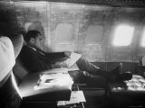 Richard M. Nixon Working on Board Plane Premium Photographic Print by Hank Walker