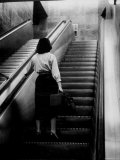 Woman Riding on Escalator in the Time and Life Building Premium Photographic Print by Nina Leen