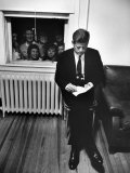 Senator John F. Kennedy Checking over Speech During His Presidential Campaign Photographie par Paul Schutzer