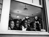 Students Looking Out the Window of the All Black Thomy Lafon School Premium Photographic Print by Robert W. Kelley