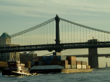 Tugboat Pulling a Barge on the East River Under the Manhattan Bridge Photographic Print by Todd Gipstein