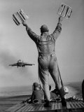 Shot of a Man Using Hand Lights to Signal an Incoming Aircraft Towards the Carrier's Landing Premium Photographic Print by Hank Walker