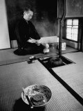 Old Monk Sitting in Cell Meditating and Performing Tea Ceremony Photographic Print by Howard Sochurek