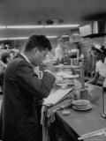 Senator John F. Kennedy Drinking a Cup of Coffee at a Cafe in Washington Airport Photographic Print by Ed Clark