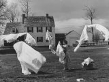 Woman Hanging Up the Laundry on the Line Photographic Print by Ed Clark