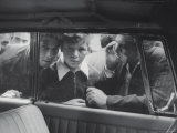 People Looking in Car Window Premium Photographic Print by Jerry Cooke