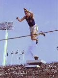 US Athlete in Action During the Pole Vault at the the Summer Olympics Premium Photographic Print by John Dominis