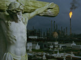 A Crucifixion Statue in Holy Rosary Cemetery Overlooks Petrochemical Plants Photographic Print by Joel Sartore