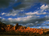 Warm Sunlight Washes over the Landscape of Cliffs in Utah Photographic Print by Barry Tessman