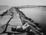 Senator Edward M. Kennedy Taking a Sunbath on Breakwater Near His Summer Home Premium Photographic Print by John Loengard