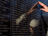 Hand Touches and is Reflected in the Vietnam Veterans Memorial Photographic Print by Todd Gipstein