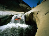 Suspended in Mid-Air, a Kayaker Sails Down a Short Waterfall and is Headed for White Water Below Photographic Print by Barry Tessman