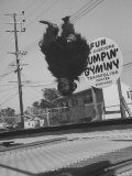 People Jumping on Trampolines Premium Photographic Print by Ralph Crane
