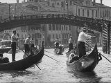People Riding in Gondolas on the Grand Canal Near the Academia Bridge Photographic Print by Dmitri Kessel