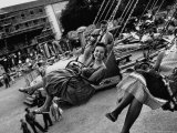 People Riding a Merry Go Round, During the Celebration of Munich's 800th Anniversary Premium-Fotodruck von Michael Rougier