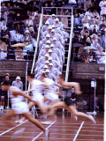 Runners Race by in a Blur as Officials Watch from the Side at the Summer Olympics Premium Photographic Print by John Dominis